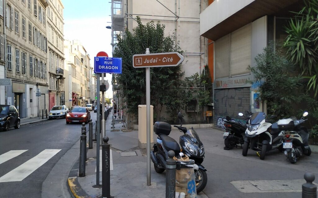 A sign points to Judai-Cite, or the Rue Saint-Suffren, a center for Jewish commerce in Marseille, October 2020. (Yaakov Schwartz/ Times of Israel)