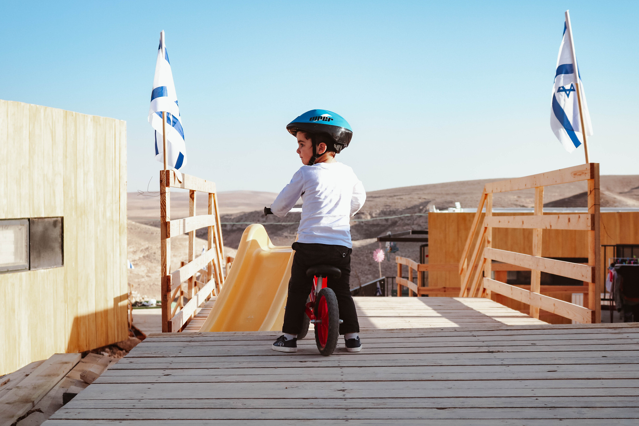 A younger resident of Shahak Heights enjoying his bike. (Shira Malul/via Ayalim)