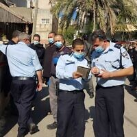 Police investigate a shooting in the northern town of Reineh, December 2, 2020 (Israel Police)