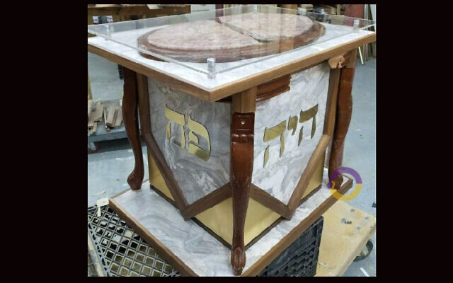 A coffee table turned defensive weapon is now a menorah stand, recalling the attack on a rabbi's home in Monsey, N.Y., last Hanukkah. (Rabbi Yisroel Kahan via JTA)
