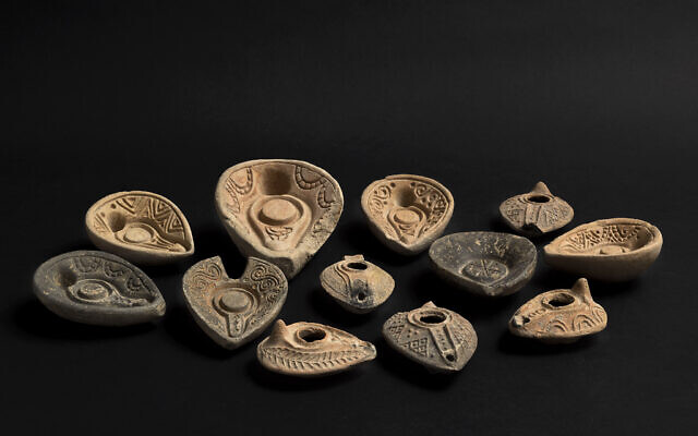 Oil lamp molds from the Islamic period (mid-7th-11th century) uncovered in the summer 2020 excavation of ancient Tiberias on display in the Israel Museum, Jerusalem, December 2020. (Ofrit Rosenberg/©The Israel Museum Jerusalem)