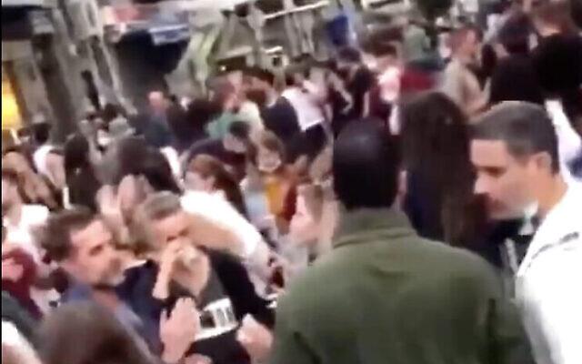 Israelis at a street party on Levinsky Street in South Tel Aviv held in apparent violation of coronavirus restrictions, December 4, 2020. (Screen capture: Twitter)
