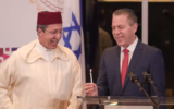 Morocco's Ambassador to the UN Omar Hilale lights Hanukkah candles with his Israeli counterpart Gilad Erdan in New York on December 17, 2020. (Screen capture/Zoom)