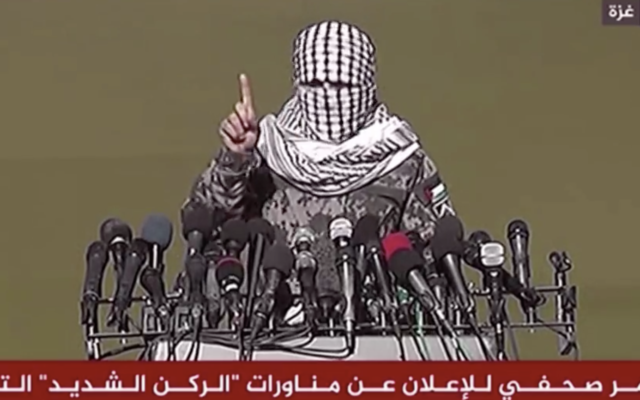A spokesperson for a joint coalition of Gaza terror groups announces the beginning of a joint military drill between Hamas, Islamic Jihad, and smaller Gaza factions on December 28, 2020 (screenshot)