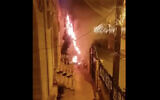 A screen capture of video from social media shows a Christmas tree that was set on fire outside a church in the northern Arab Israeli city of Sakhnin, December 30, 2020. (Screen capture: Twitter)
