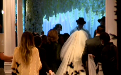An Orthodox Jewish wedding taking place in contravention to COVID-19 restrictions at the Hilton Chicago Northbrook hotel, December 2, 2020. (Screen capture: CBSN Chicago)