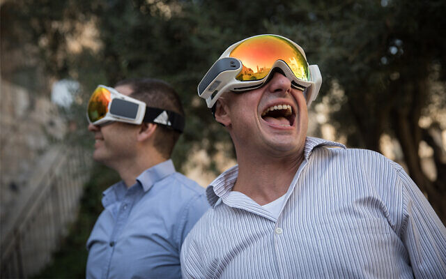Illustrative: People take a view through augmented reality glasses as start-up firms showcase products at an Innovation Lab event at the Tower of David Museum in Jerusalem, October 17, 2017. (Hadas Parush/Flash90)