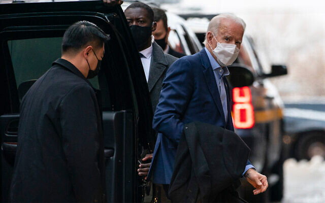 US President-elect Joe Biden arrives at The Queen theater in Wilmington, Delaware, December 17, 2020. (AP Photo/Carolyn Kaster)