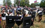 White nationalist demonstrators in Lee Park in Charlottesville, Virginia, August 12, 2017. (AP Photo/Steve Helber)