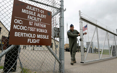 Illustrative: A US Air Force officer closes the gate at an ICBM launch control facility at an air force base in the countryside outside Minot, North Dakota, June 24, 2014. (AP Photo/Charlie Riedel)
