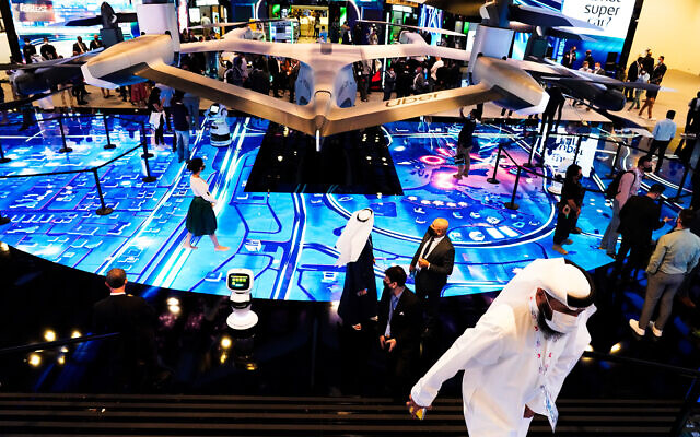 People visit an exhibit at the GITEX technology summit in Dubai, United Arab Emirates, Dec. 7, 2020. (AP Photo/Jon Gambrell)