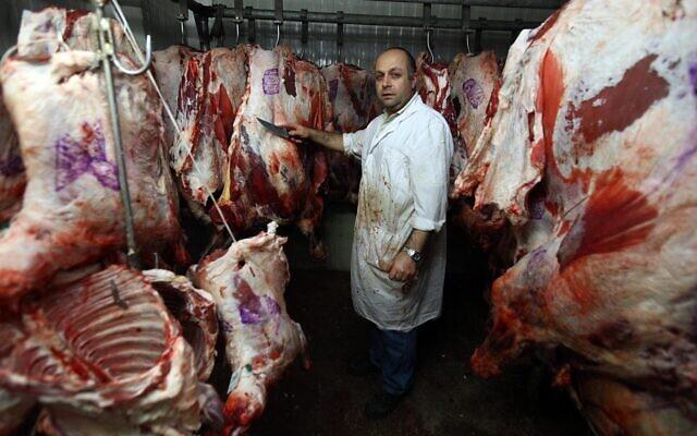 Illustrative: A butcher in Jerusalem, April 26, 2010. (Abir Sultan/Flash90)