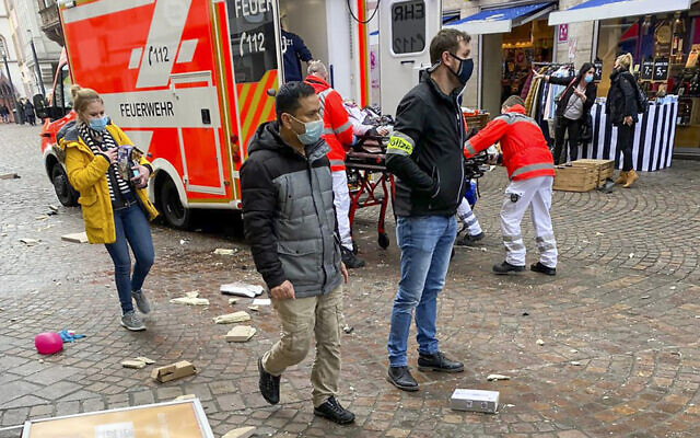 Rescuers push an injured person into an ambulance after a car drove into pedestrians in Trier, southwestern Germany, on December 1, 2020. (Sebastian Schmitz/AFP/lokalo.de)