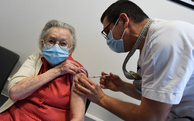 A resident of a retirement receives a dose of the Pfizer/BioNtech COVID-19 vaccine, in Loos, northern France, on December 28, 2020. (Francois Lo Presti/AFP)