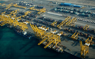 Container ships dock at the Dubai Port in the Jebel Ali Free Zone, United Arab Emirates, Jan. 3, 2010. (AP Photo/Kamran Jebreili)