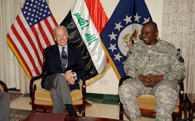 Then US Vice President Joe Biden, left, with then General Lloyd Austin, the top US commander in Iraq, in Baghdad, Iraq, Nov. 29, 2011. (AP Photo/Khalid Mohammed)