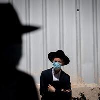 Illustrative: Ultra-Orthodox Jewish people attend a funeral in Jerusalem, October 12, 2020. (Yonatan Sindel/Flash90)