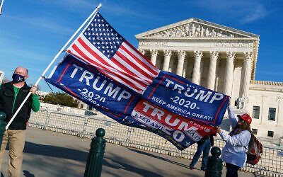 Trump supporters demonstrate at the US Supreme Court in Washington, December 11, 2020. (AP Photo/J. Scott Applewhite)