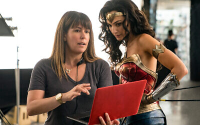 "Director Patty Jenkins, left, and actress Gal Gadot on the set of ""Wonder Woman 1984."" (Clay Enos/Warner Bros. Entertainment via AP)"