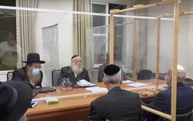 Screen capture from video of a meeting between health officials and lead ultra-Orthodox rabbis in the city of Bnei Brak aimed at encouraging coronavirus vaccination in the local community. (YouTube)