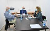 Amnon Straschnov, center, Avraham Ben Shushan, left and Yisraela Friedman meeting to discuss the submarine affair inquiry on December 1, 2020. (Ariel Hermoni, Defense Ministry)
