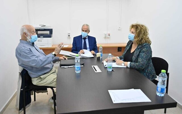 Amnon Straschnov, center, Avraham Ben Shushan, left and Yisraela Friedman meeting to discuss the submarine affair inquiry on December 1, 2020. (Ariel Hermoni, Defense Ministry)