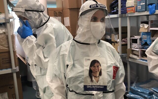 Israeli doctor Orly Ashkenazi, working as part of an aid delegation at the Ospedale Michele e Pietro Ferrero Hospital in Piedmont, Italy. A sticker on her protective gear states her name and shows a photo of her for the benefit of patients. (Sharon Yaniv/Sheba Medical Center)