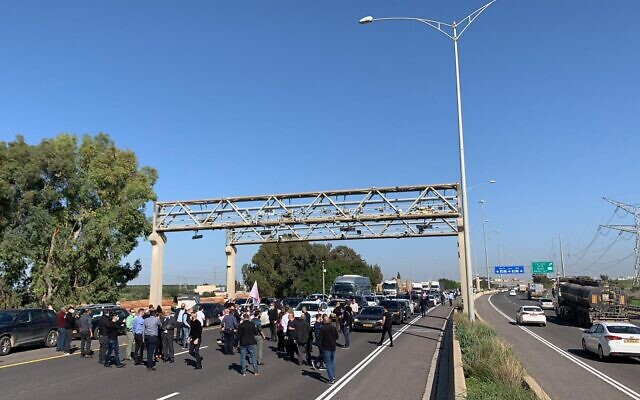 Arab Israeli lawmakers and demonstrators block Route 6 in protest of what they allege is government inaction in the face of violence in Arab cities and towns (Credit: Joint List)