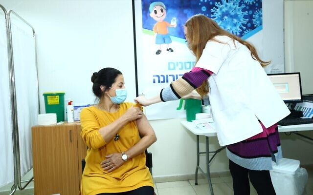 A Jerusalem woman receives a COVID-19 vaccine at a center run by the Clalit healthcare provider (courtesy of Clalit)