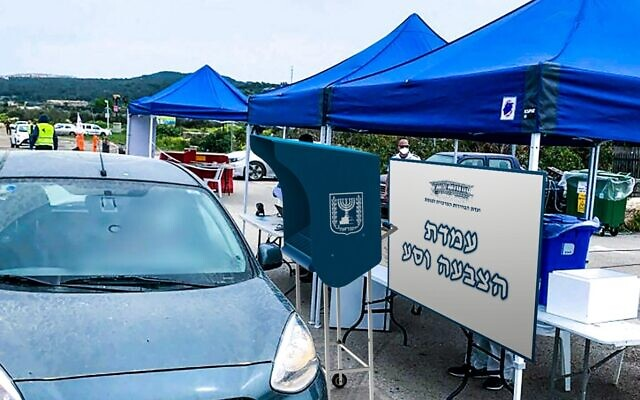 "A demo photo of a ""Vote and drive station"" provided by the Central Elections Committee on December 28, 2020, shows a model of a drive-thru voting station for coronavirus carriers that will be set up for the elections on March 23, 2021. (Central Elections Committee)"