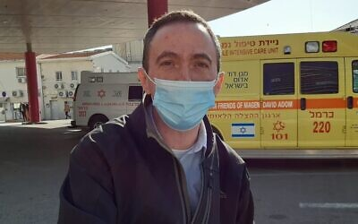 Rabbi Mike Schultz outside of Rambam Medical Center on December 30, 2020. (Nathan Jeffay/Times of Israel)