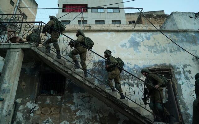 Golani Brigade soldiers search for the killer of one of their comrades, Amit Ben-Ygal, in the West Bank village of Yabed in an undated photograph. (Israel Defense Forces)
