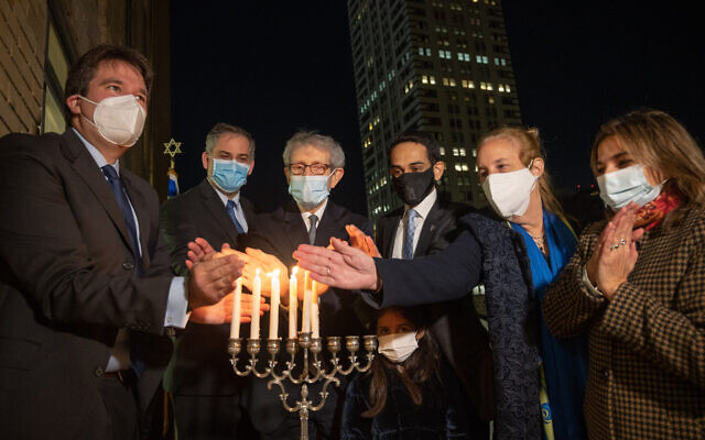 (From L-R) East End Temple Rabbi Joshua Stanton, Israel New York Acting Consul General Israel Nitzan, JCRC-NY CEO Michael Miller, UAE New York Consul General Abdalla Shaheen, Cordoba House executive director Naz Ahmed Georga and Manhattan Borough president Gayle Brewer light Hanukkah candles in Manhattan on December 14, 2020. (Shahar Azran)