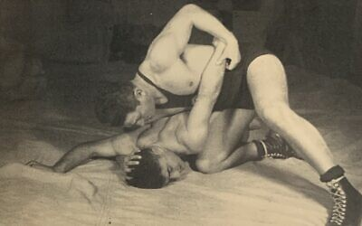Zalman Unreich (On) teaching wrestling in Palestine, 1930s. Photo appeared on collecting cards and in book titled, 'Mishmar VeSport' (https://www.nli.org.il/he/books/NNL_ALEPH002015431/NLI)