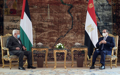 Palestinian Authority President Mahmoud Abbas (L) meets with Egyptian President Abdul Fattah el-Sissi, in Cairo on November 30, 2020. (WAFA Images/Thayer Ghanayem)