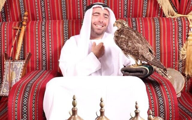 Israeli singer Omer Adam poses for a photo with a falcon in the United Arab Emirates (Instagram photo)