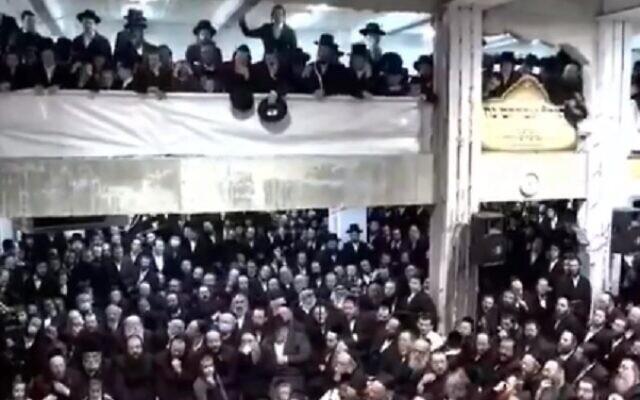 Members of the Pnei Menachem community in Jerusalem celebrate Hanukkah without adhering to coronavirus restrictions, December 17, 2020 (video screenshot)