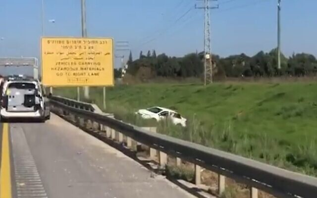 A car is seen by the roadside on Route 6 after it was shot at on December 28, 2020. One man died and another was critically injured in the suspected revenge attack (video screenshot)