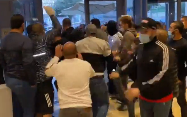 Dozens of Israelis who had returned from abroad attempt to break out of a forced quarantine in the Leonardo hotel in Jerusalem, December 28, 2020. (Screen Capture: Channel12)