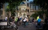 Cyclists demonstrate for more bike lanes in Tel Aviv, December 14, 2018. (Miriam Alster/Flash90)
