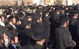 Thousands of ultra-Orthodox Jews defy coronavirus restrictions to attend a funeral for Rabbi Yisroel Chaim Menashe Friedman,  a longtime judge of the Satmar rabbinic court in Brooklyn on  December 7, 2020 (Screencapture/New York Post)