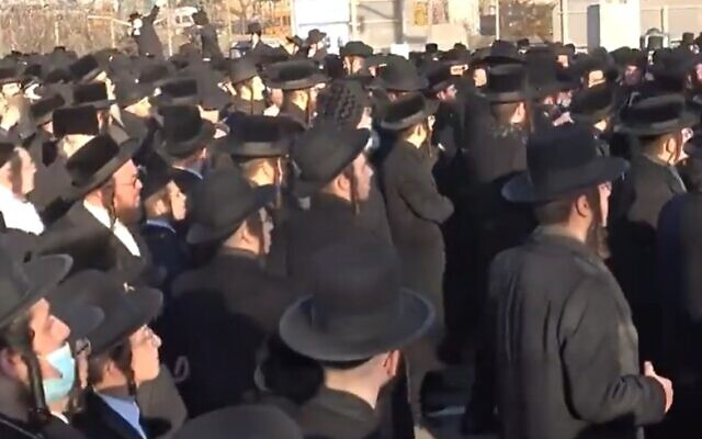Thousands of ultra-Orthodox Jews defy coronavirus restrictions to attend a funeral for Rabbi Yisroel Chaim Menashe Friedman,  a longtime judge of the Satmar rabbinic court in Brooklyn on  December 7, 2020 (Screencapture/New York Post)