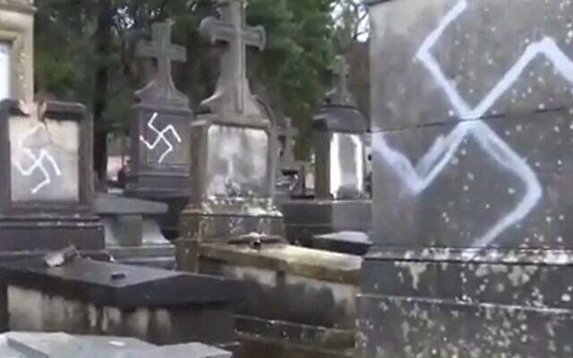 Graves defaced with swastikas in the French town of Fontainebleau, December 28, 2020 (Screen grab/BFM)