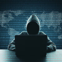 Illustrative: Hacker using laptop on abstract binary code map background. (Peshkov/ iStock, by Getty Images)