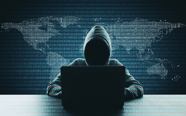 Illustrative: Hacker using laptop on abstract binary code map background. (Peshkov/iStock, by Getty Images)
