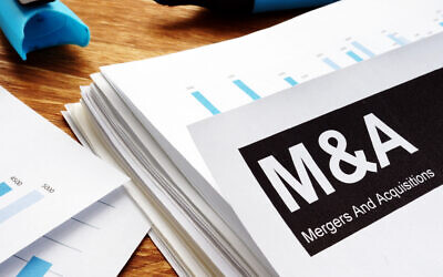 An illustrative image of a merger and acquisition deal (designer491; iStock by Getty Images)