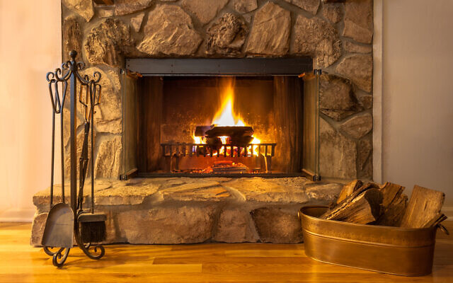 Illustrative: A fire burns in a stone fireplace (Carol A Hudson; iStock by Getty Images)