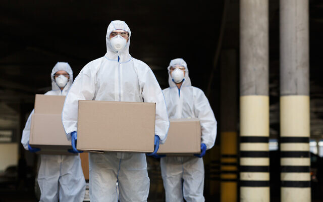 Illustrative: Couriers in protective clothing deliver vaccine supplies (Prostock-Studio via iStock by Getty Images)