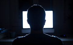 Illustrative: Silhouette of a man's head in front of a computer monitor (tommaso79; iStock by Getty Images)