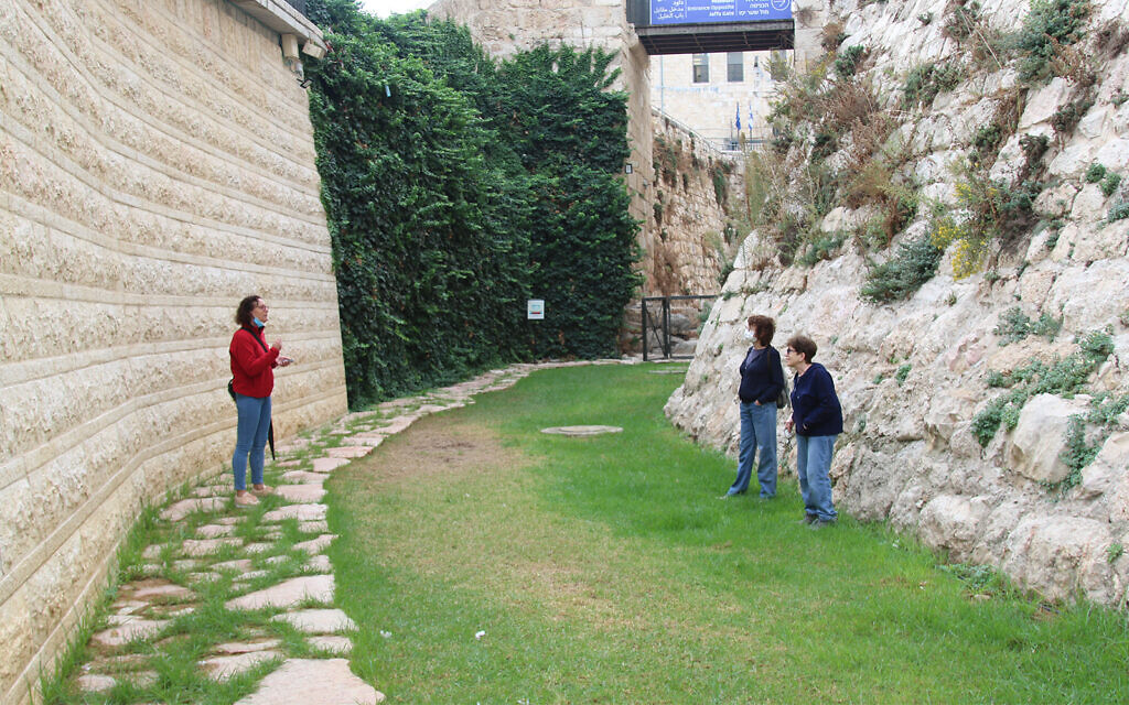 Visitors to Jerusalem's Old City in the dry moat that surrounds the Crusader-era citadel in the Tower of David Museum. Castle moats in Europe were filled with water, but Jerusalem's was left dry, due to lack of water. (Shmuel Bar-Am)